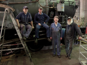 Staff and volunteers in the Eveleigh Railway Workshop