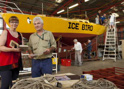 Volunteers and staff working on the conservation of the 'Icebird' yacht at the Discovery Center in 2012.