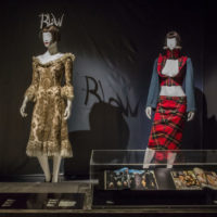 Fashion mannequins dressed in gold and tartan costumes