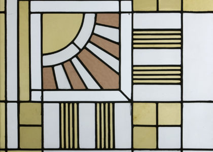 Detail of Art Deco stained-glass light panels in a starburst pattern.