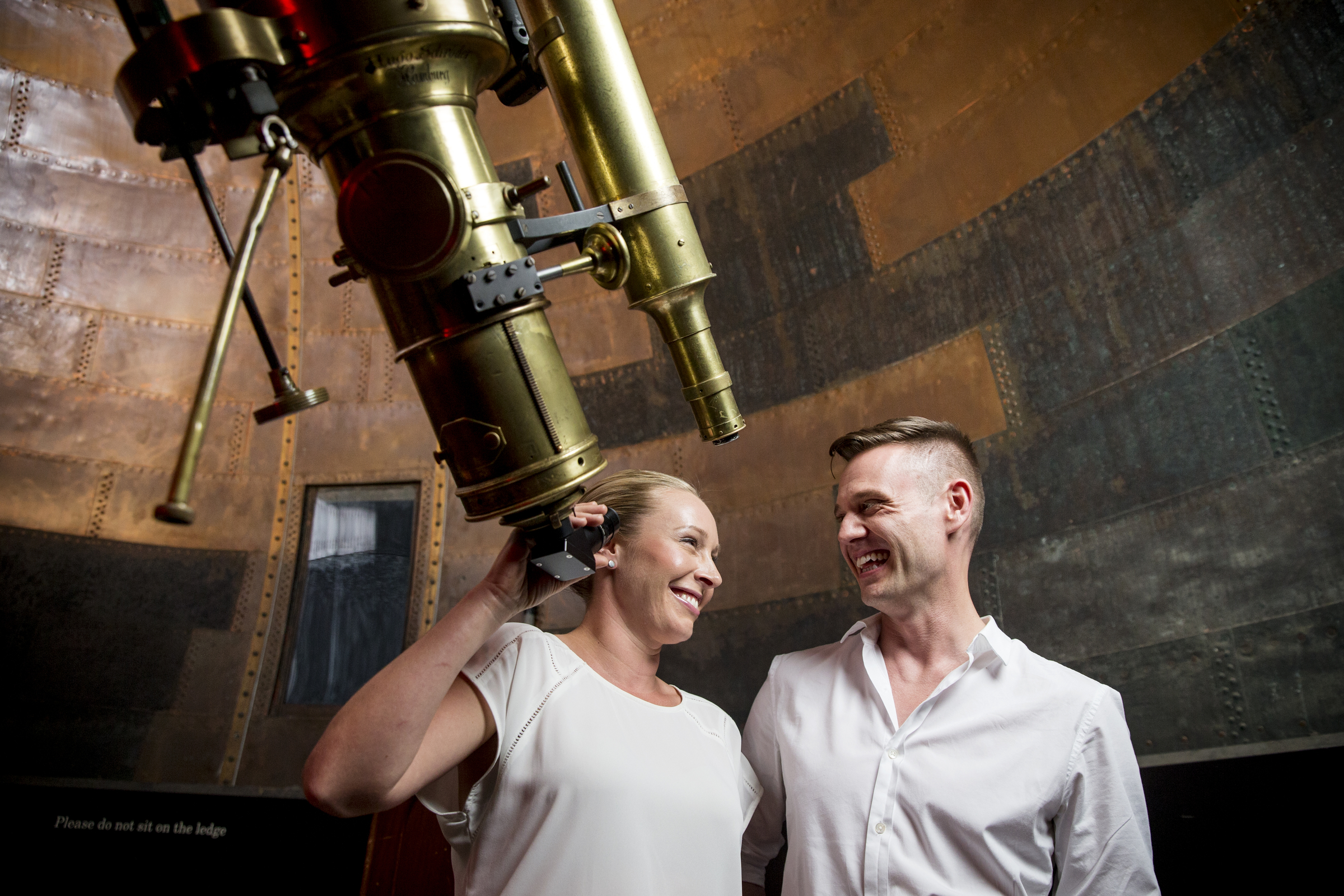 Man and woman with a telescope at Sydney Observatory.