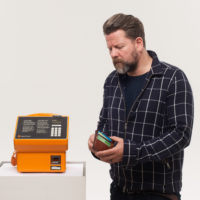 Tim Ross looking for change with the Museum's Gold Phone copy