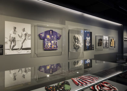 Australian Men's Style display made up of mounted photographs and garments in glass cabinets