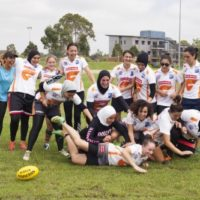 Auburn Giants (formerly Tigers) football team at training session at the University Western Sydney, Milperra campus AFL field, for Faith, fashion, fusion: Muslim women's style in Australia travelling exhibition. Group of players.