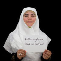Mona Marabani holding a sign saying
