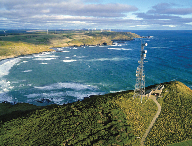 Aerial shot of the beautiful rugged landscape and wind turbines of Cape Grim