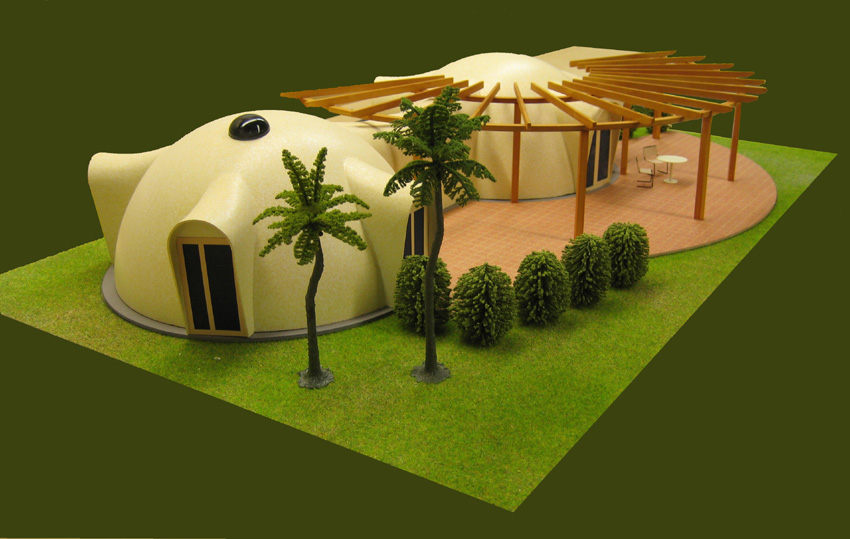 A model shows two light-coloured domes that are linked together to create a house.