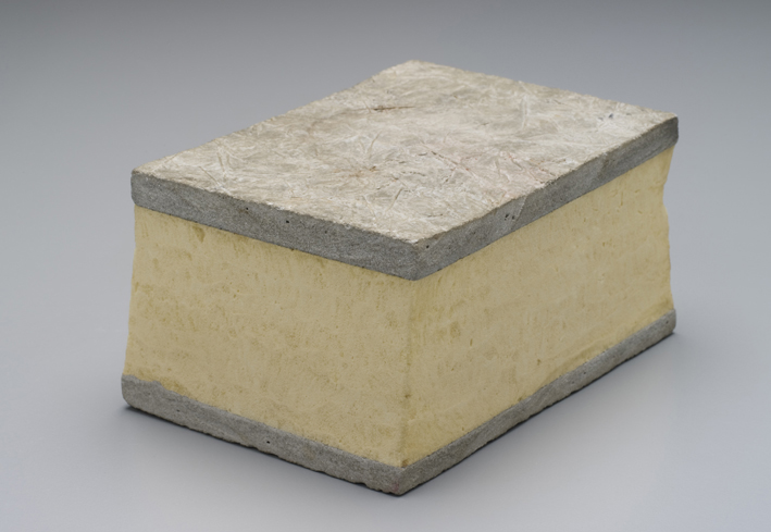A layer of yellow polyurethane is sandwiched between two much thinner layers of concrete in the DomeShell wall.