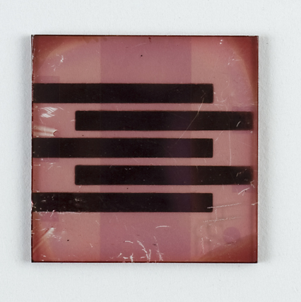 Dark stripes appear on a light pink background in this printed solar cell.