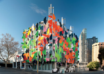 Colourful shades are fixed at varying angles all over two sides of the Pixel building.