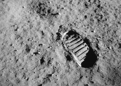 Astronaut footprint in grey moon soil.