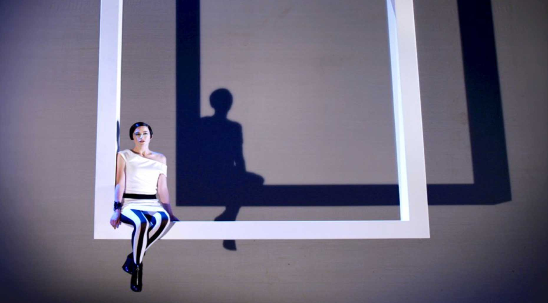 Woman sitting on a large square frame. Image supplied by Anna Tregloan