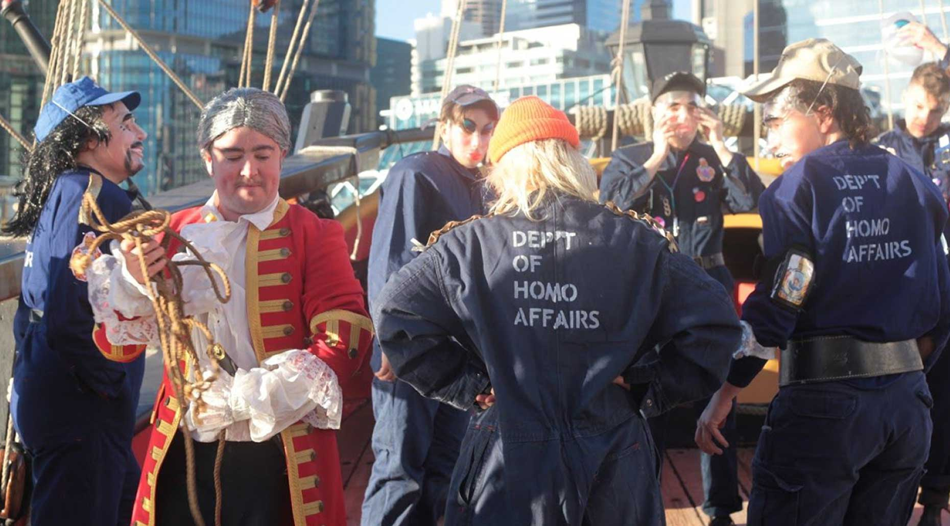 People dressed up on a ship at Sydney Harbour. Image supplied by Department of Homo Affairs.