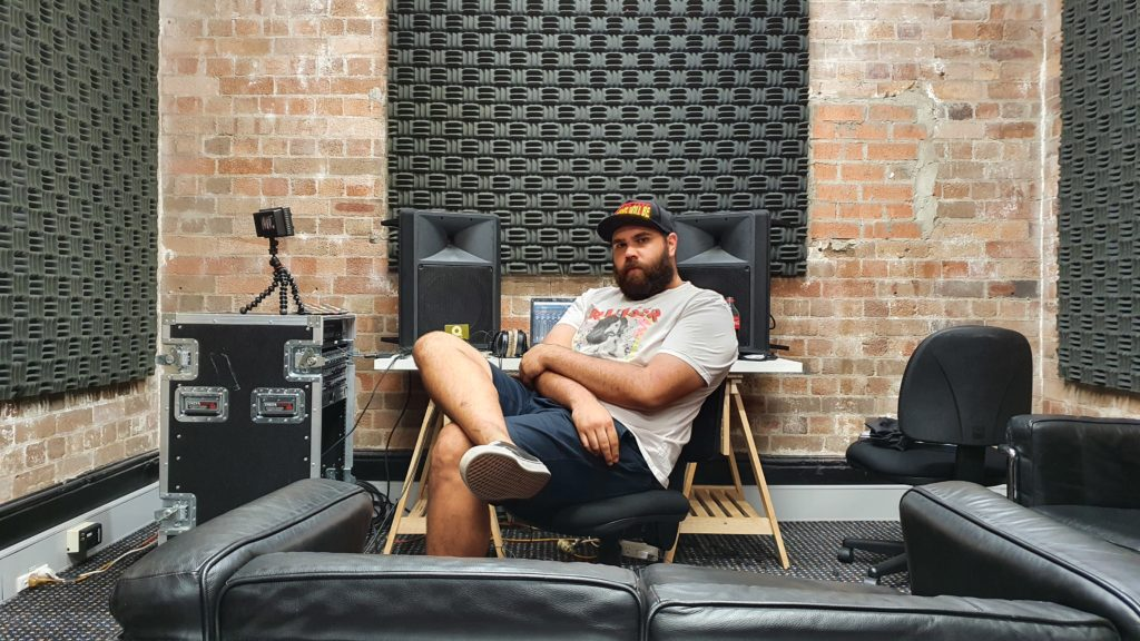 Blake Rhodes sits on a chair inside the Powerhouse Generations studio