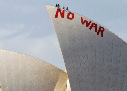 "Will Saunders and David Burgess climb the Sydney Opera House to paint the slogan ""NO WAR"", 2003 AAP Image/Mick Tsikas"