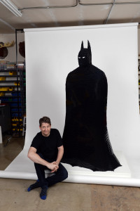 Artist Nathan Sawaya with his LEGO creation of The Darkest Knight