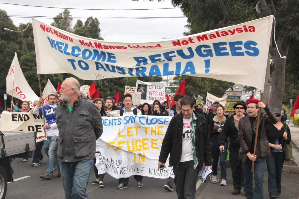 People rallying in support of asylum seekers and refugees in Melbourne, Australia. April 2013. Photograph by John Englart