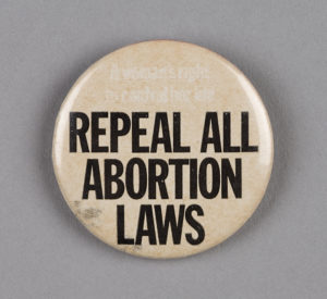 'Repeal All Abortion Laws' badge