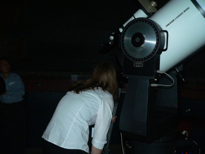 Observatory guide Gemma adjusts the 40-cm Meade telescope in Sydney Observatory's north dome. Image Ross Mitchell.