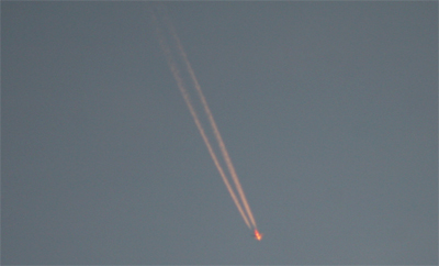 Photograph of a contrail across the sky