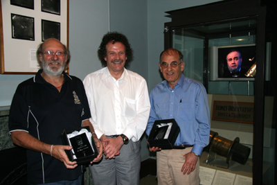 Dr Wayne Orchiston, Mike Chapman President of the Sydney City Skywatchers, Dr Nick Lomb and Henry Chamberlain Russell on the monitor to the right.