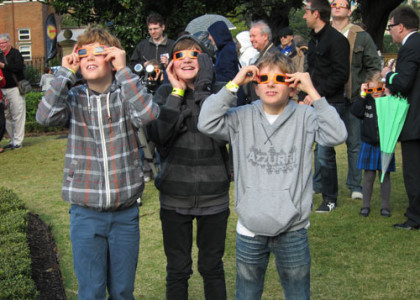 Three young visitors safely watch the transit of Venus through Sydney Observatory solar specs