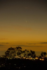 Comet C/2011 L4 (PANSTARRS) as seen from Castle Hill, Sydney on March 6, 2013 witha plane flying above. Photo and copyright Geoff Wyatt ©, all rights reserved