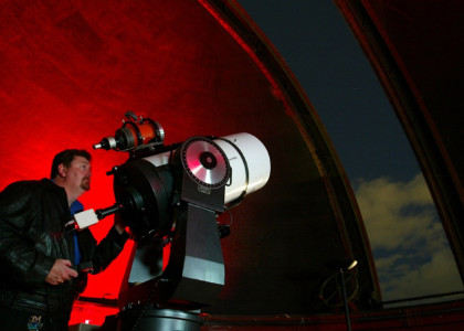 Geoff Wyatt using the north dome telescope, image courtesy AAP Reuters