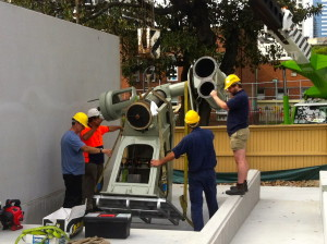 The Astrograph mount is carefully manoeuvred into place by Carey, Ralph and Barry