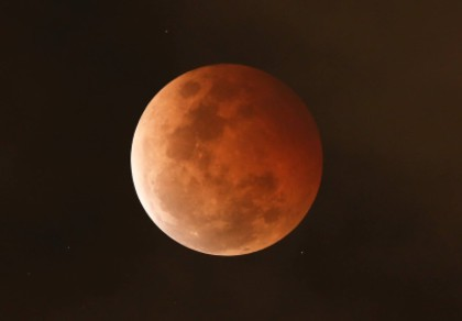 The full Moon reddened during the total lunar eclipse of October 8 2014. Image copyright Geoff Wyatt.
