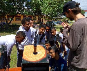 Portuguese astronomer Nuno Carvalho teaching the students about sunspots using the solarscopes to project the image of the Sun. Photographed with permission, copyright Toner Stevenson ©, all rights reserved.