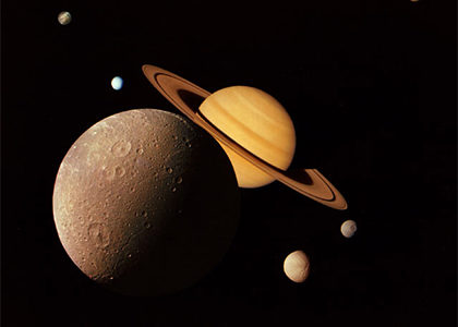 Close up image of Saturn and its moons
