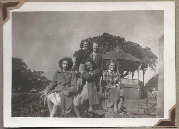 Five women star measurers on Observatory Hill in Sydney in front of the rotunda.