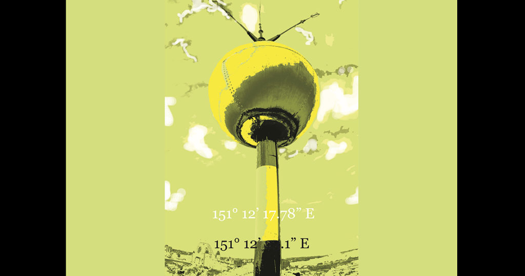 Metal yellow ball on a pole against a yellow background.