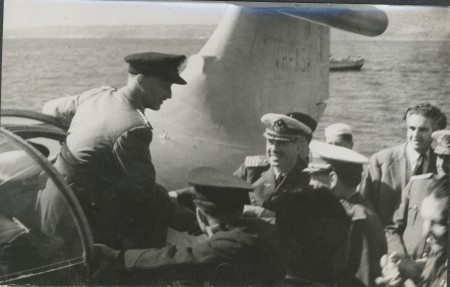 P.G. Taylor in the port blister meeting Chilean Air Force officers