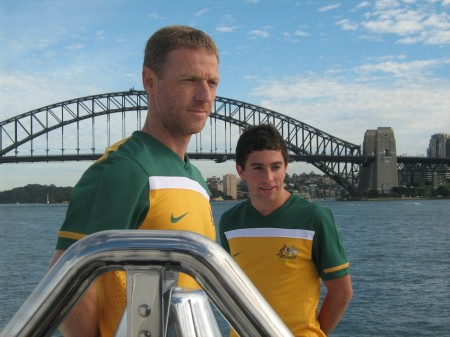 Figures wearing Australian green and gold soccer shirts