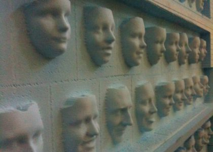 Relief 3D printed faces on a wall