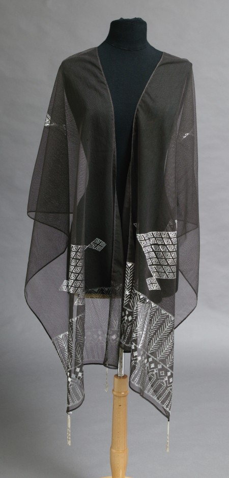 Sheer black shawl on a mannequin