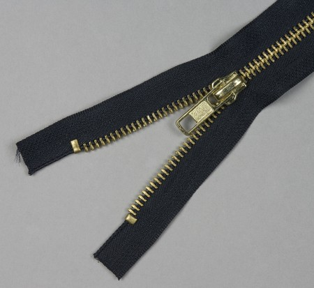 Close up image of black and gold zipper