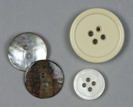 Close up photograph of 4 different buttons
