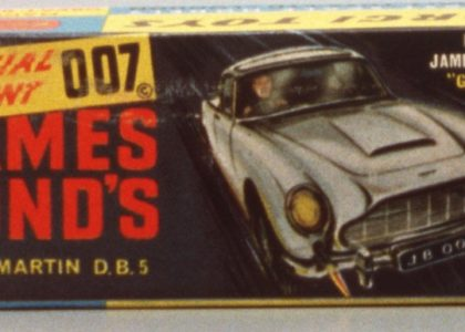 "Illustration of James Bond in Aston Martin with the Text ""Special Agent 007 - James Bond's Aston Marin D.B.5"""