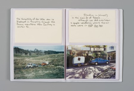 Notebook open with photos of caravan being towed and notes about where it is