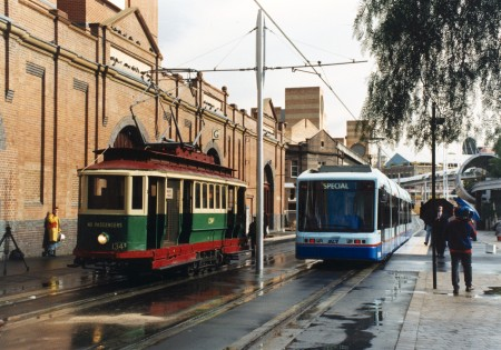 Modern day ultimo with an old tram and modern tram running side by side