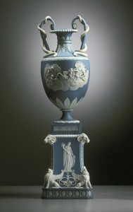 Wedgewood vase in pale blue with white detailed images as decorative pieces