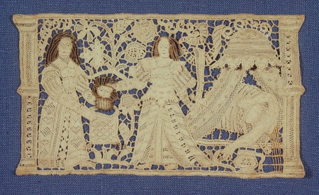 Lace image of two women and baby with human hair used to represent hair in the image