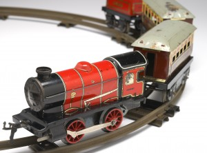 Model tin steam train on track