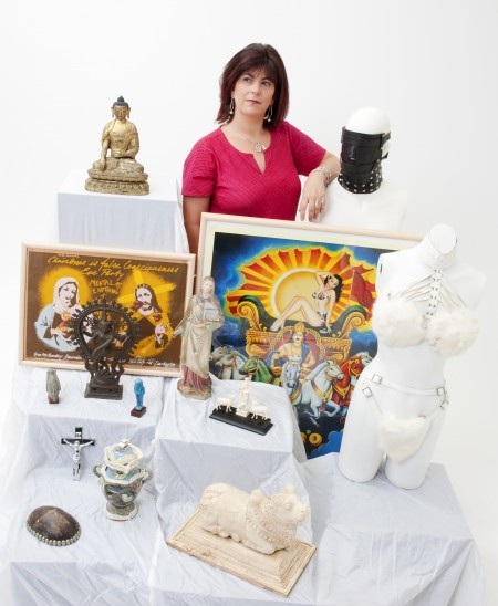 Rebecca Bower surrounded by museum objects