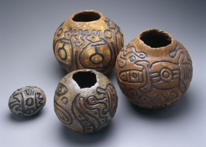 Photograph of 4 stoneware pots