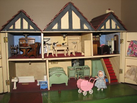 Opened dolls house revealing the interior