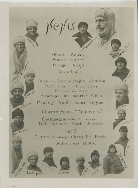 """Photograph of a menu celebrating Christmas in 1930 on board the ship """"Discovery"""" with photographs of the British Australian and New Zealand Antarctic Expedition members 1929-1931"""